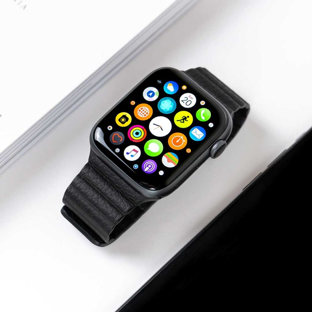 Apple Watch On Table Displaying Home Screen